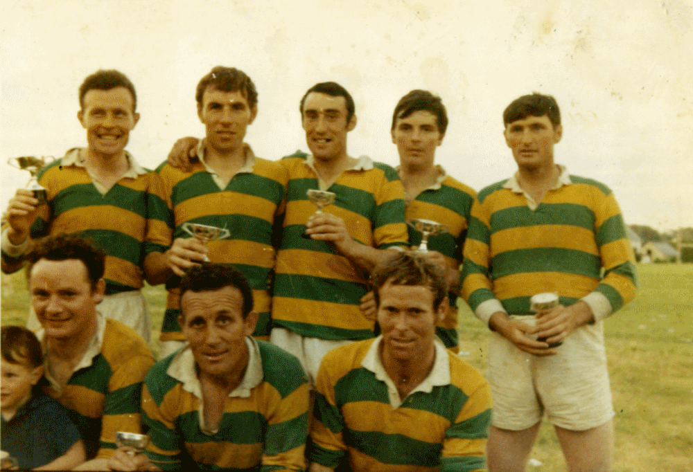 Back Row (L to R) Johnny Fitzpatrick, Johnny Sammon, Joe Mannion, Joe Mortimer and Mikey Kane. Front Row (L to R) Chip Conneely, John Conneely (Mascot), Paddy Fitzpatrick and Charlie O Malley.  Photo courtesy of Chip Conneely.