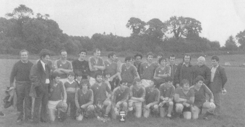 Renvyle, 1984 West Board Junior A League Champions. Back Row (L to R): Johnny Fitzpatrick (Manager), Willie Gannon (Manager), Thomas Heanue (Obscured), Chip Conneely, Brendan Mullen, Thomas Flaherty, Johnny Sammon, Thady Salmon, Paddy Fitzpatrick, Patrick Lydon, Joe Heanue, Michael Henaue, Niall Malone, Patrick McDonnell, John Flaherty and Kevin McDonnell. Front Row (L to R): John Diamond, David Walsh (Mascot), Brendan Flaherty (Mascot), Joachim Lydon, Liam Walsh, Louise Sammon (Mascot), Gerry Salmon, Stephen Flaherty, Sean Peter Fitzpatrick, John Heanue and Johnny Coyne. Photograph courtesy of Renvyle GAA.