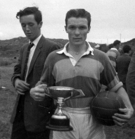 Above: Renvyle Captain, Petie Kane, keeps a firm grip on both the Mongan Cup and the Match Ball after Renvyle completed a three in a row at Woods in September 1962.