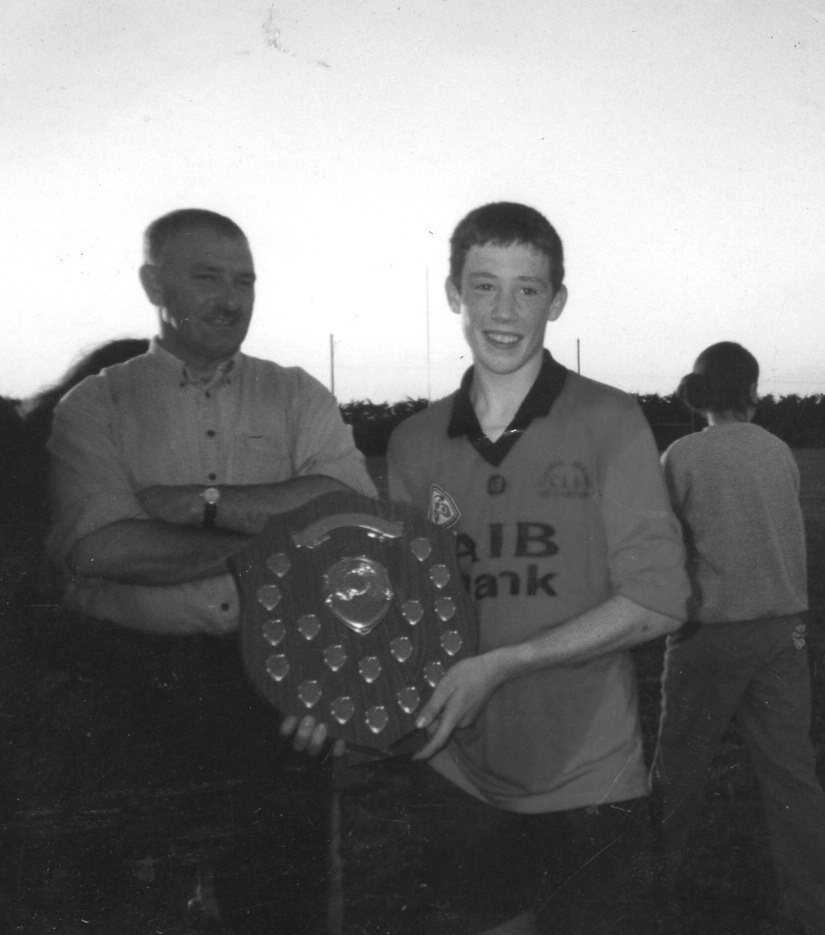 Renvyle U14 Captain Michael Aspell pictured with the Victory Shield after his side's historic victory over Menlough. Standing alongside Michael is Joint Manager Tommy Kane. Photo courtesy of Eilish O'Neill.