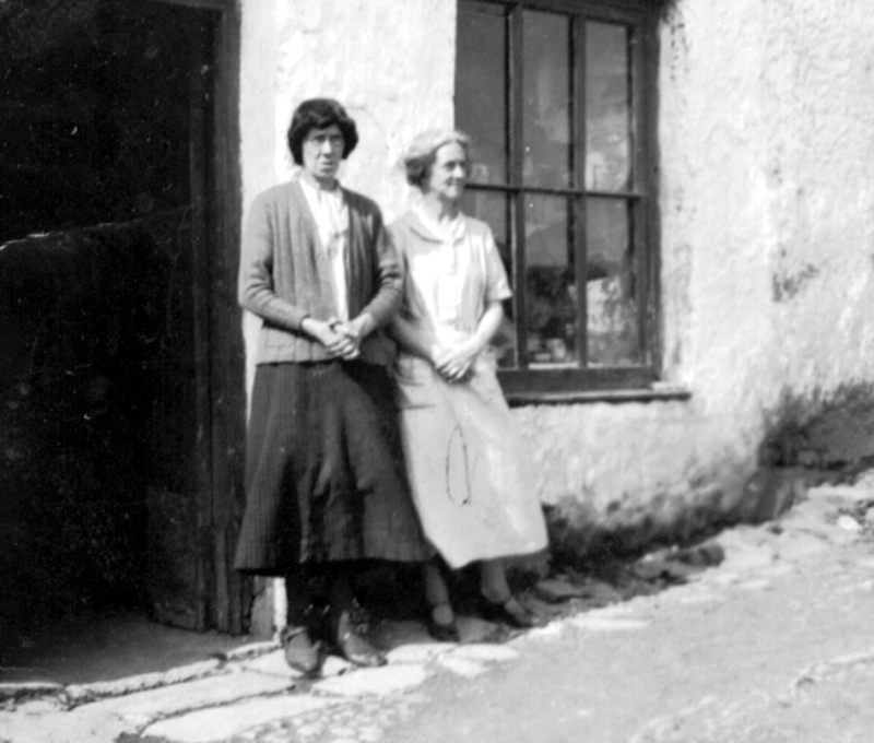 Maggie Flaherty with a tourist, outside her shop in Tully.